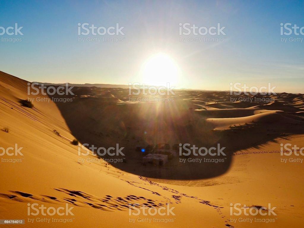 Sunset over Erg Chebbi sand dunes stock photo