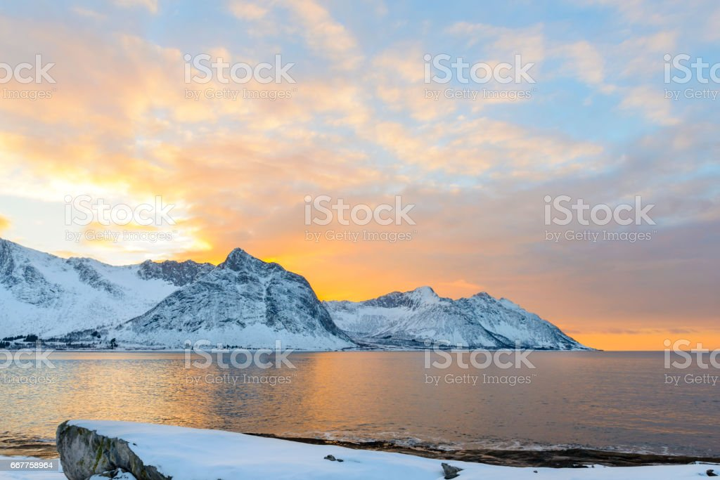 Sunset over Ersfjord on Senja island in Northern Norway in winter stock photo