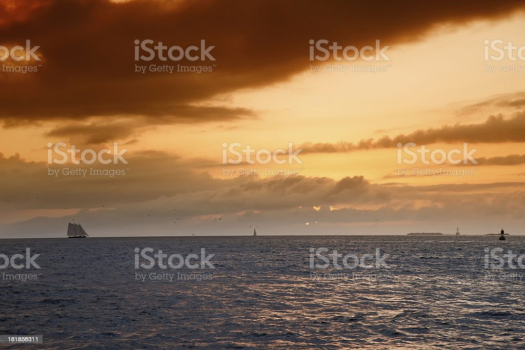 Sunset over estuary with tide coming in royalty-free stock photo
