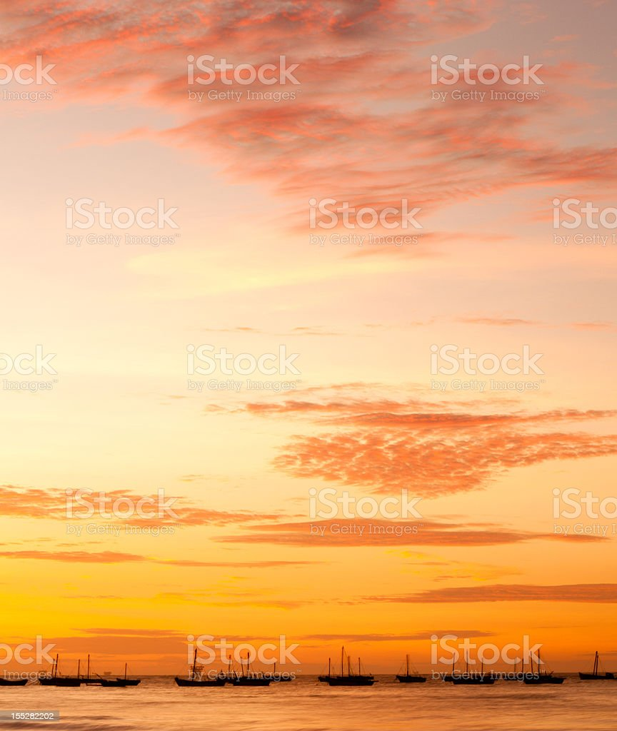 Sunset over fishing boats in rural Peru stock photo