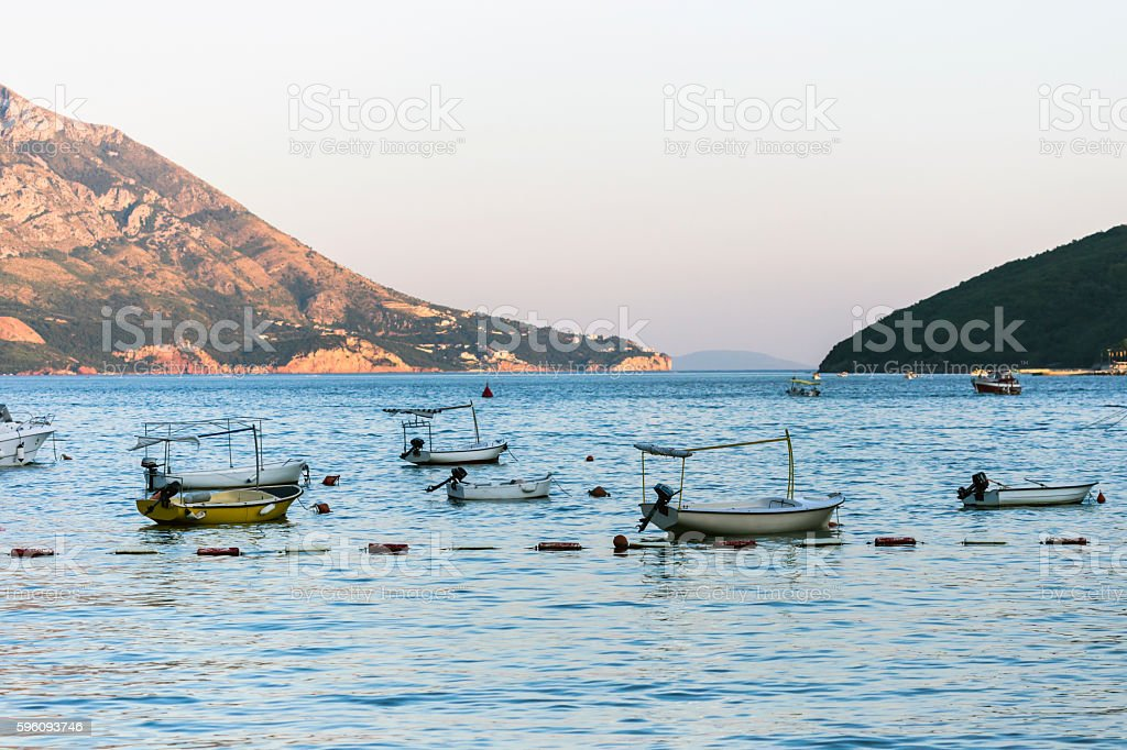 Sunset over fishing boats stock photo