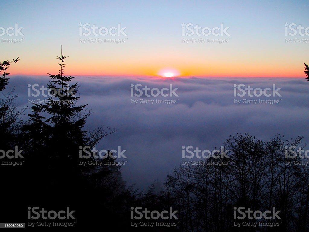 Sunset over fog Horizontal royalty-free stock photo