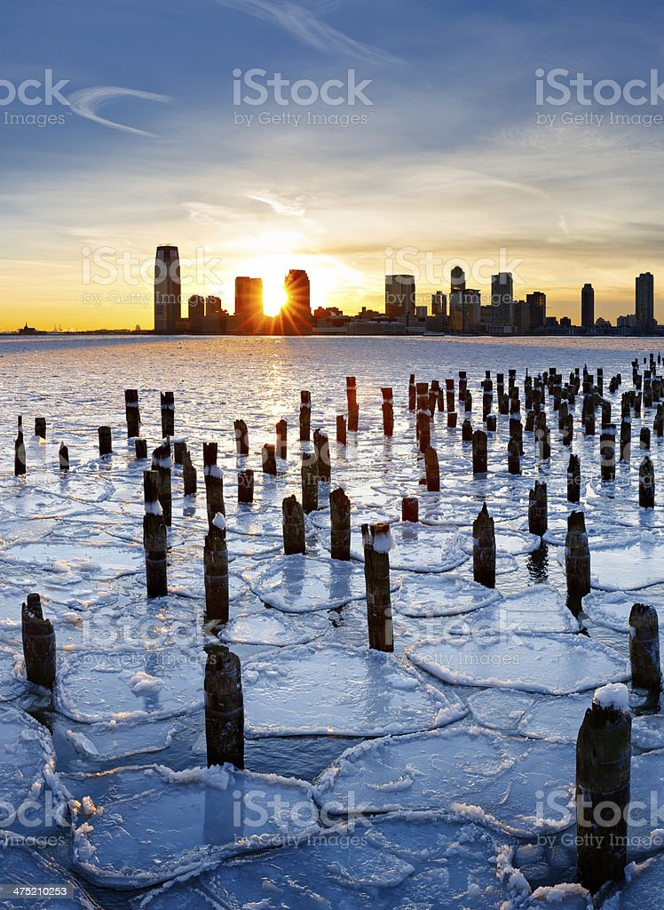 Sunset over Frozen Hudson River and Jersey City stock photo