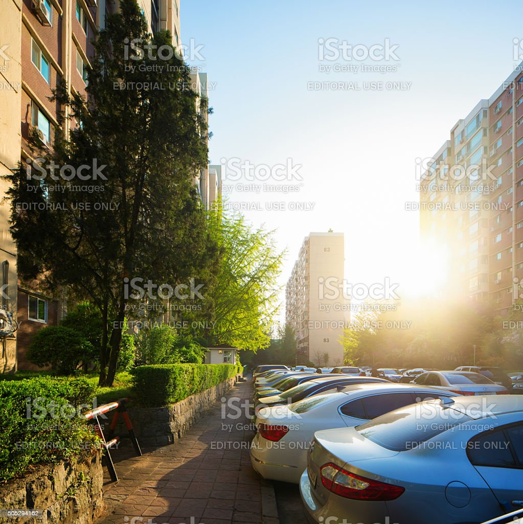 Sunset over Gangnam apartment buildings and parking lot stock photo