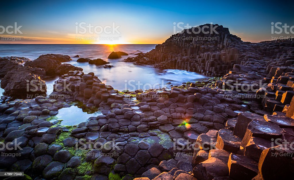 Sunset over Giants Causeway, Northern Ireland. stock photo