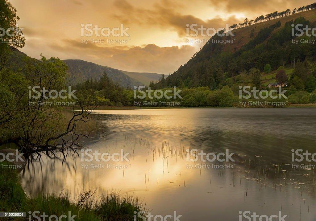 Sunset over Glendalough lower lake, ireland stock photo