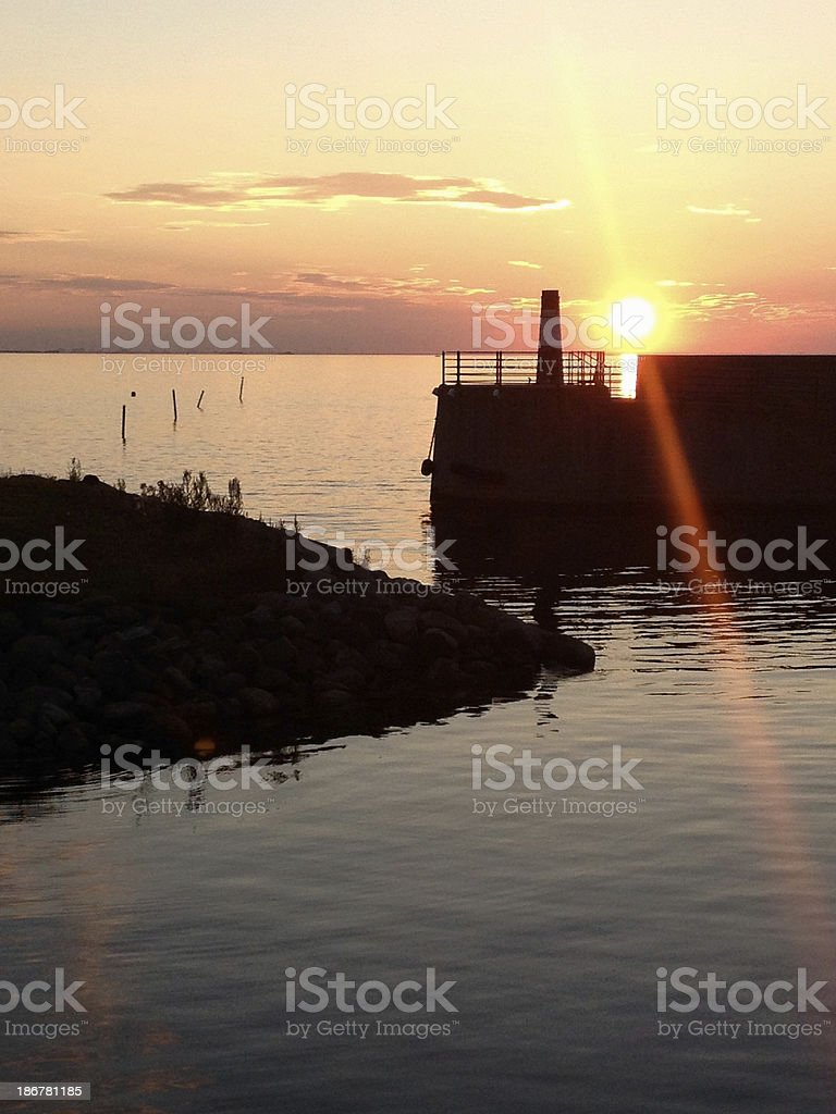 Sunset over harbour stock photo