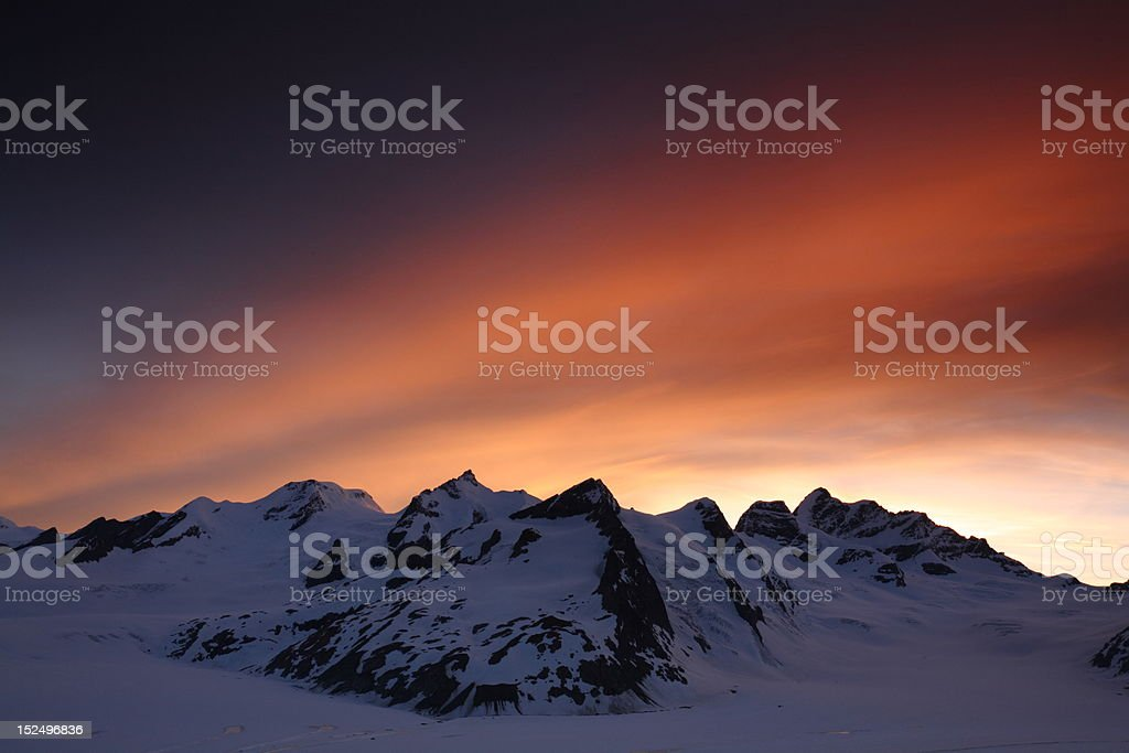 Sunset over high mountain summits in the Swiss Alps royalty-free stock photo