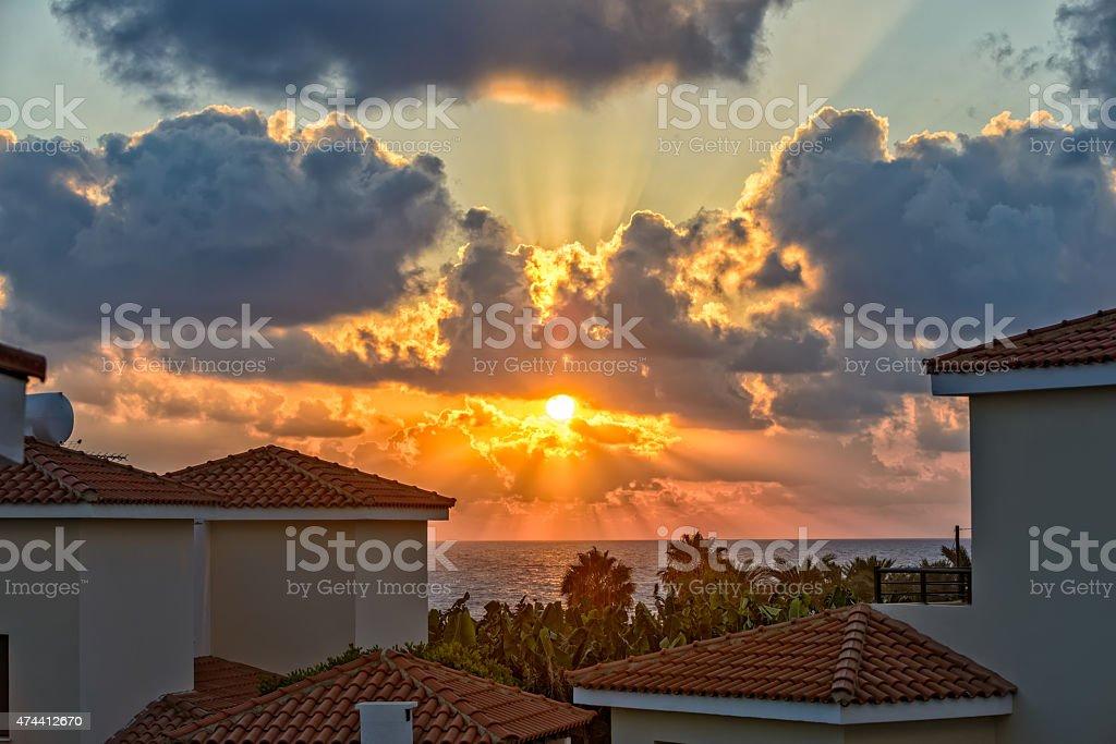 Sunset over holiday beach villas on Cyprus coast stock photo