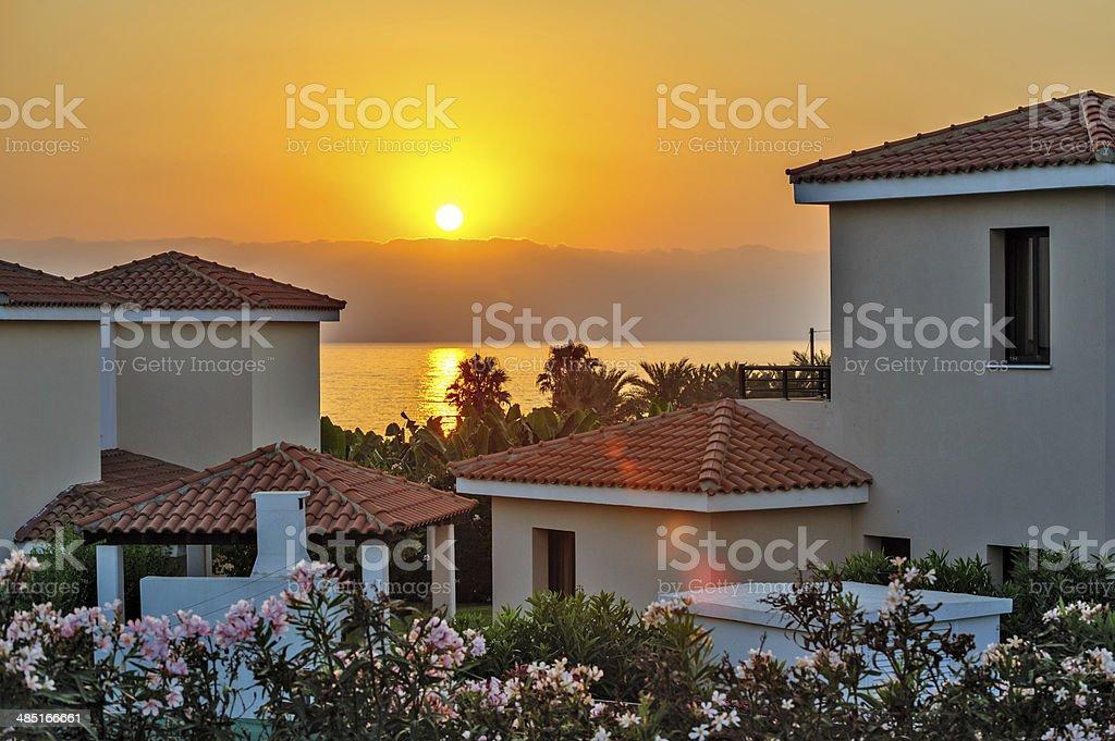 Sunset over holiday beach villas stock photo