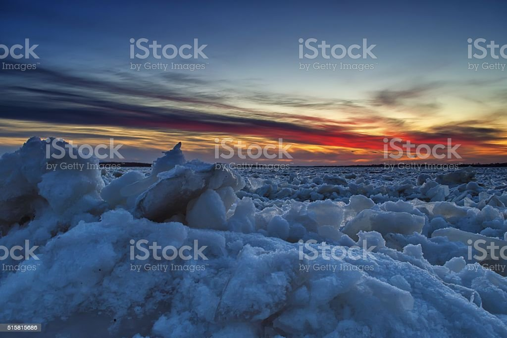 Sunset over ice-cold, lifeless planet stock photo
