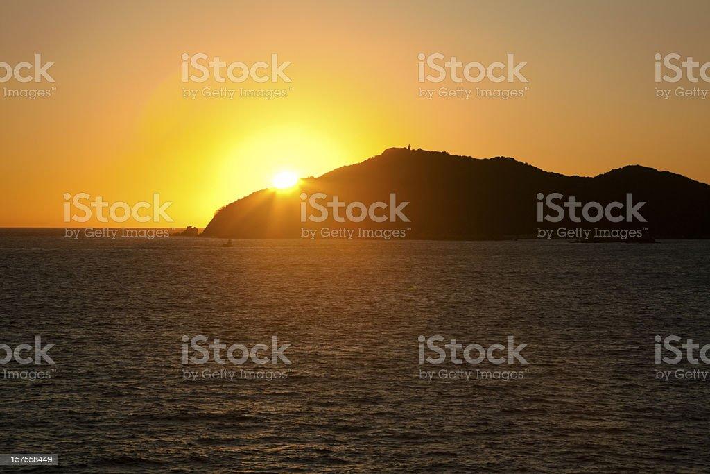 Sunset Over Isla la Roqueta, Acapulco Bay, Mexico stock photo