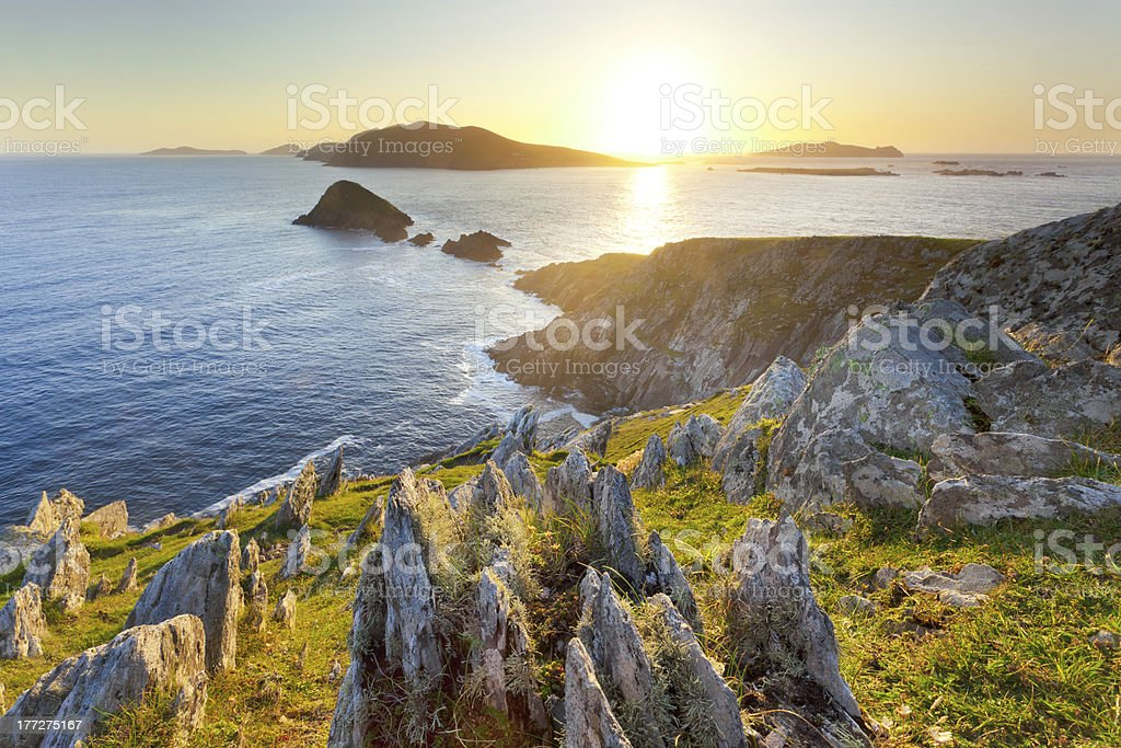 sunset over islands on irish west coast stock photo