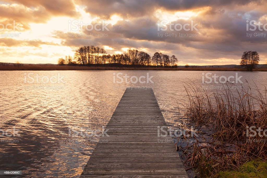 Sunset over jetty on the Elbe river stock photo