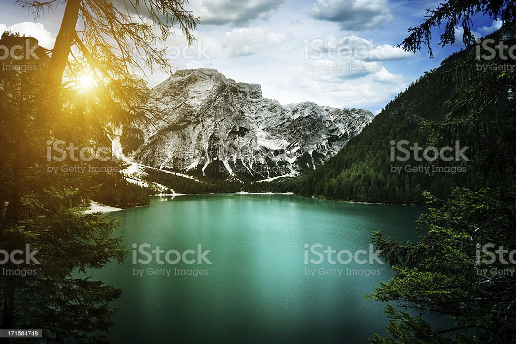 Sunset over lake in mountains royalty-free stock photo