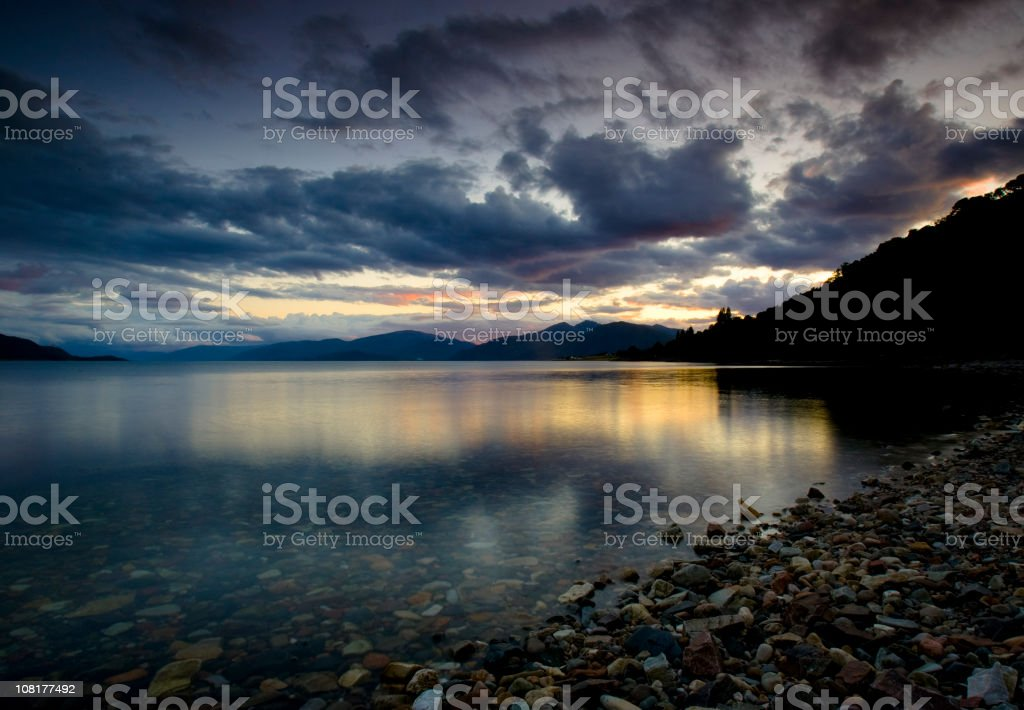 Sunset Over Lake Loch Leven with Mountains in Background royalty-free stock photo