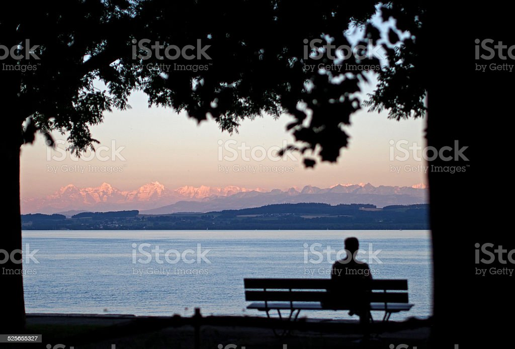 Sunset Over Lake Neuchatel in the Swiss Alps stock photo