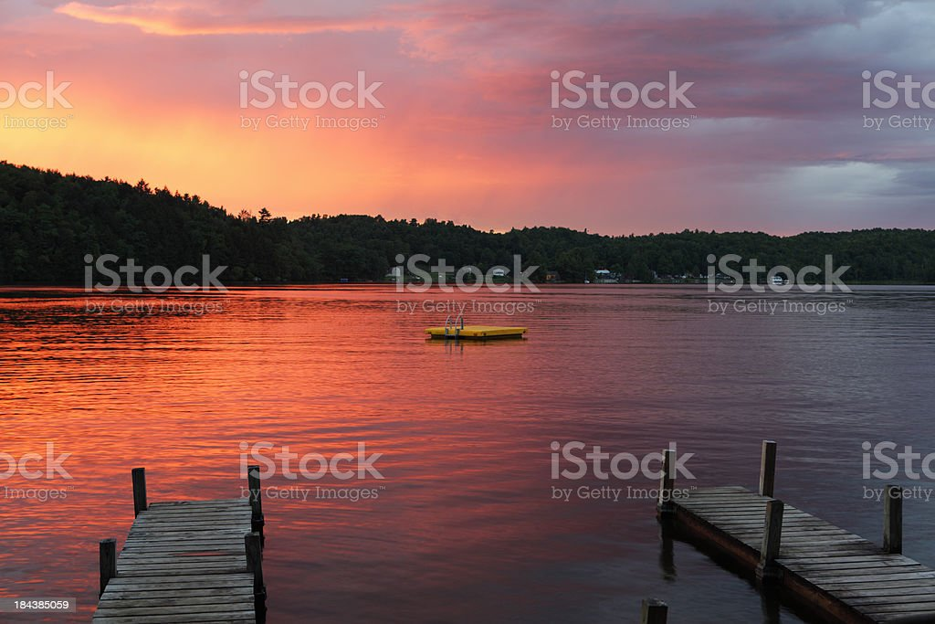Sunset over lake with jetty royalty-free stock photo