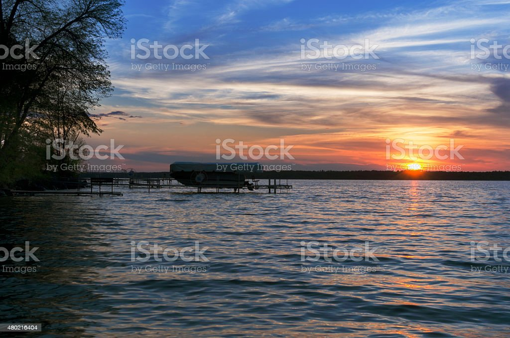 Sunset Over Leech Lake With Boat In Background stock photo