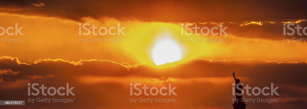 Sunset over Liberty stock photo