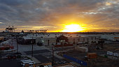 Sunset over Lowe's and Shipping Cranes