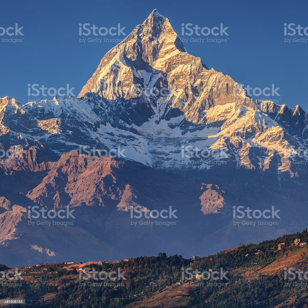 Sunset over Machapuchare seen from Pokhara, Nepal royalty-free stock photo