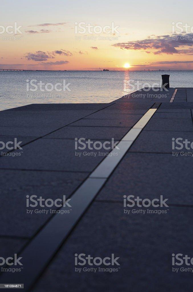 sunset over modern shoreline stock photo