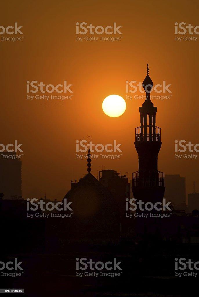 Sunset over mosque minaret in Cairo Egypt stock photo