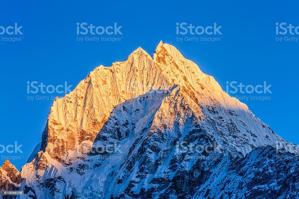 Sunset over mount Thamserku in Himalayas, Nepal stock photo