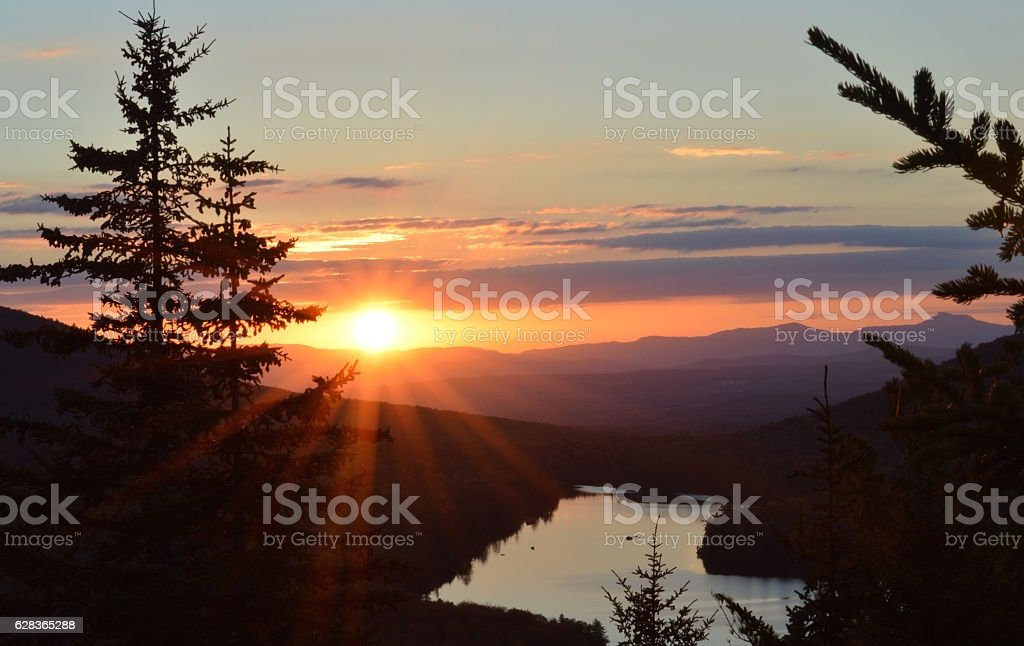 Sunset over mountains, lake and pine trees, Vermont stock photo