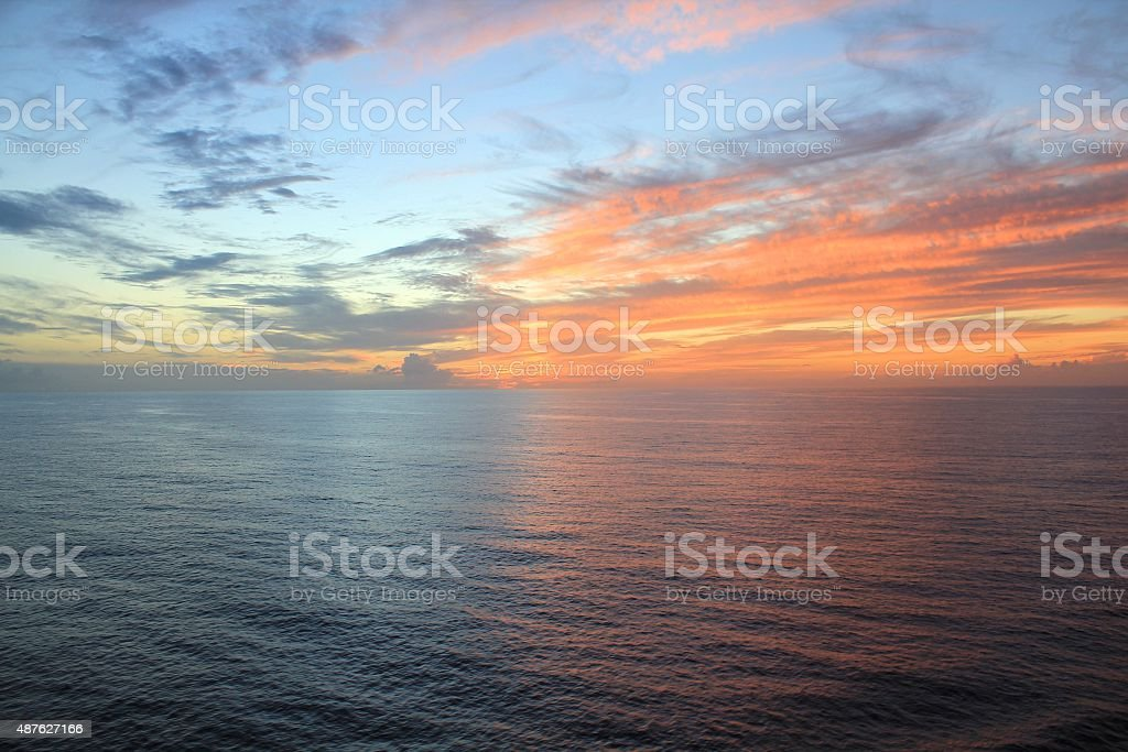 Sunset over ocean stock photo
