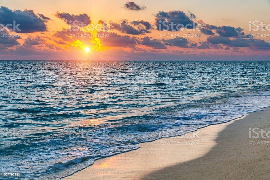 Sunset over ocean stock photo