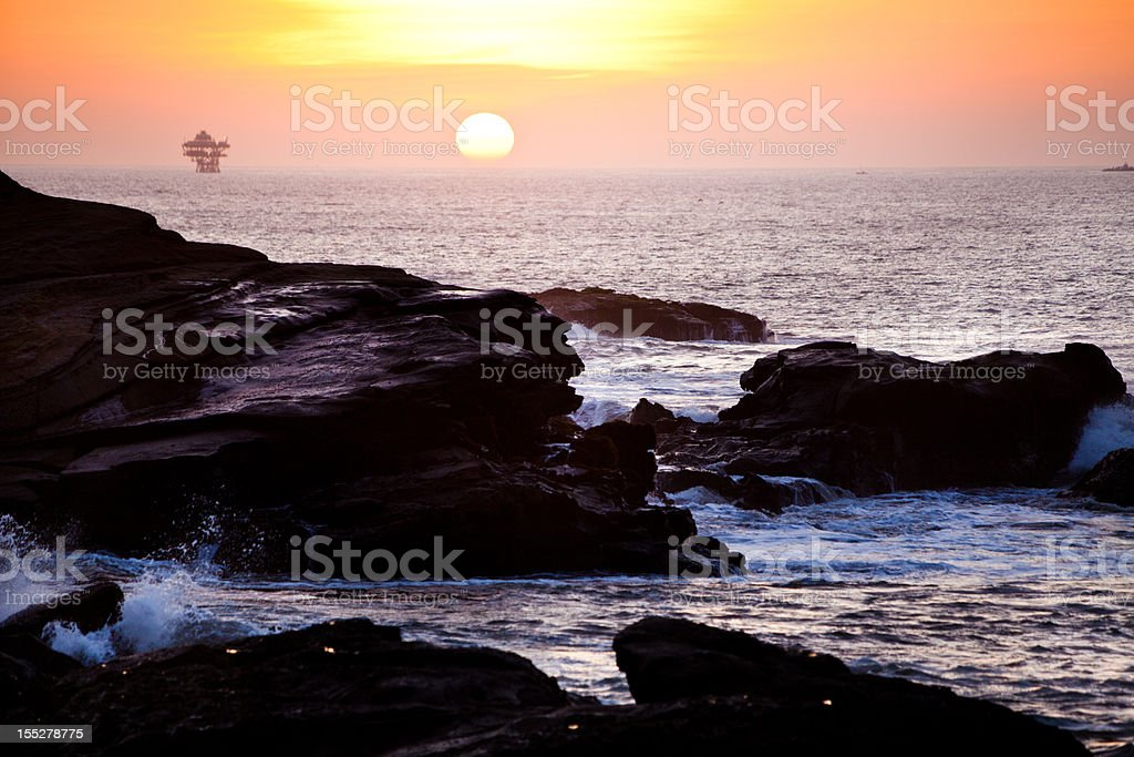 Sunset over off shore oil platforms in Peru royalty-free stock photo