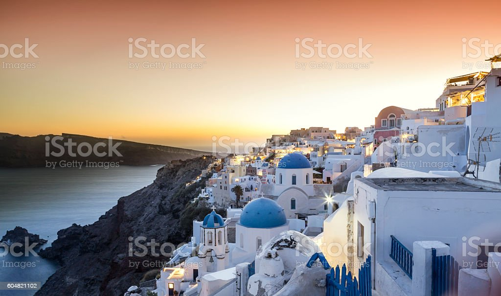 Sunset over Oia village in Santorini island of Greece stock photo