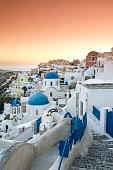 Sunset over Oia village in Santorini island of Greece