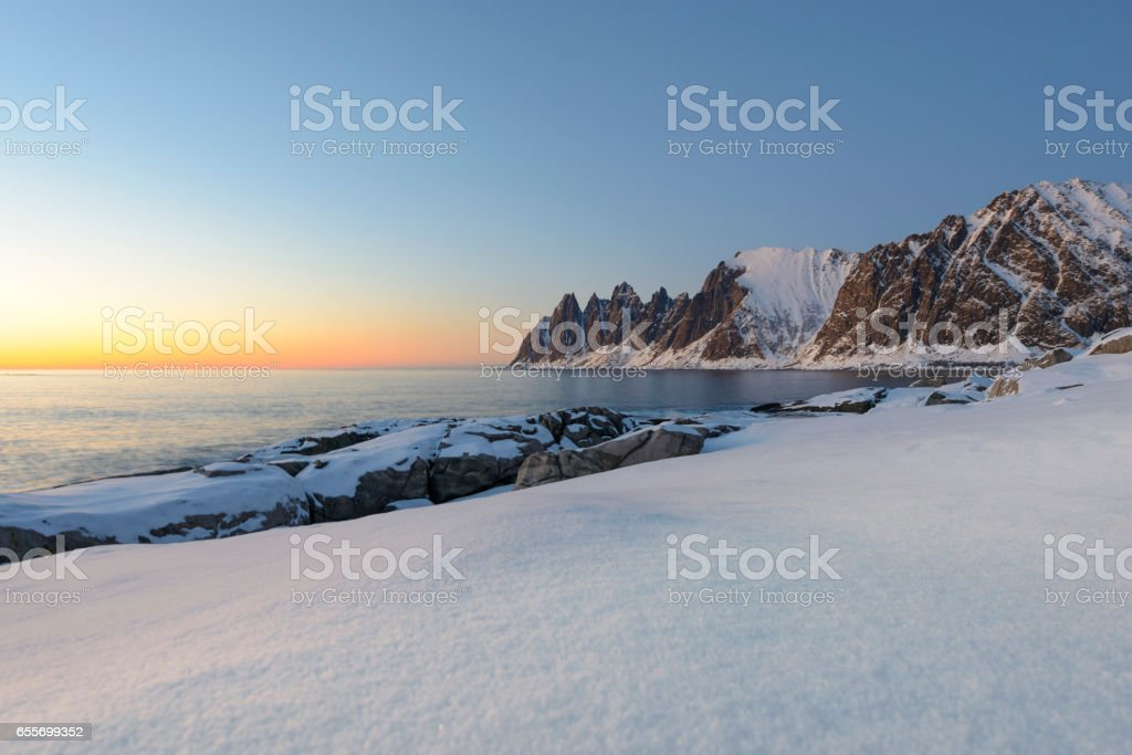 Sunset over Okshornan mountain range in Northern Norway in winter stock photo