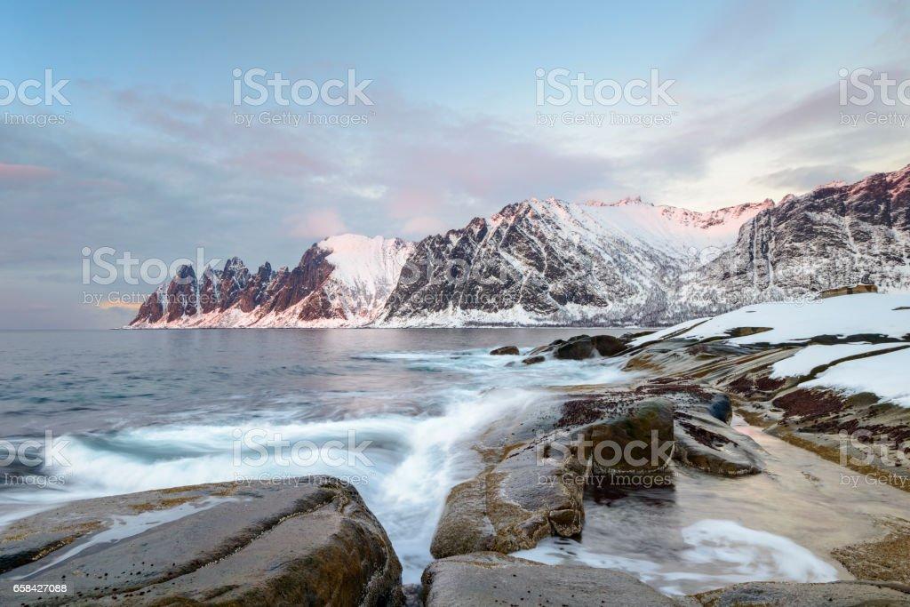 Sunset over Okshornan mountain range in Northern Norway in winter stock photo