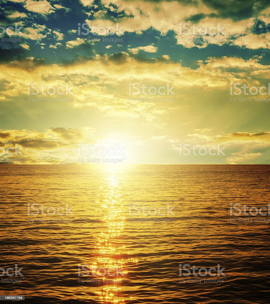 sunset over orange water royalty-free stock photo