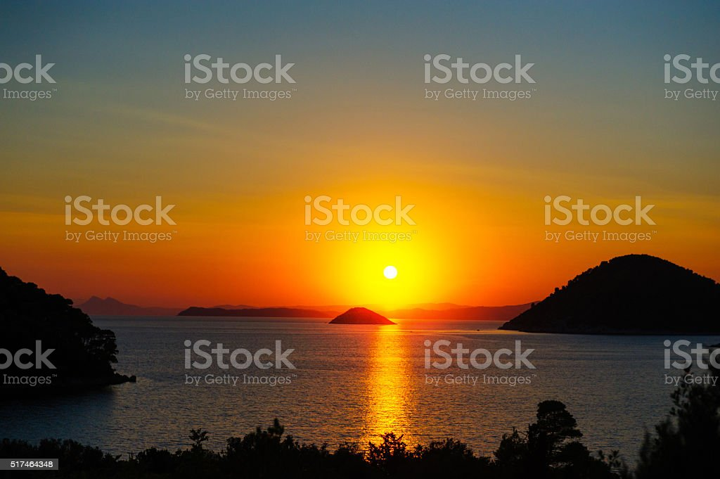 Sunset over Panormos bay stock photo