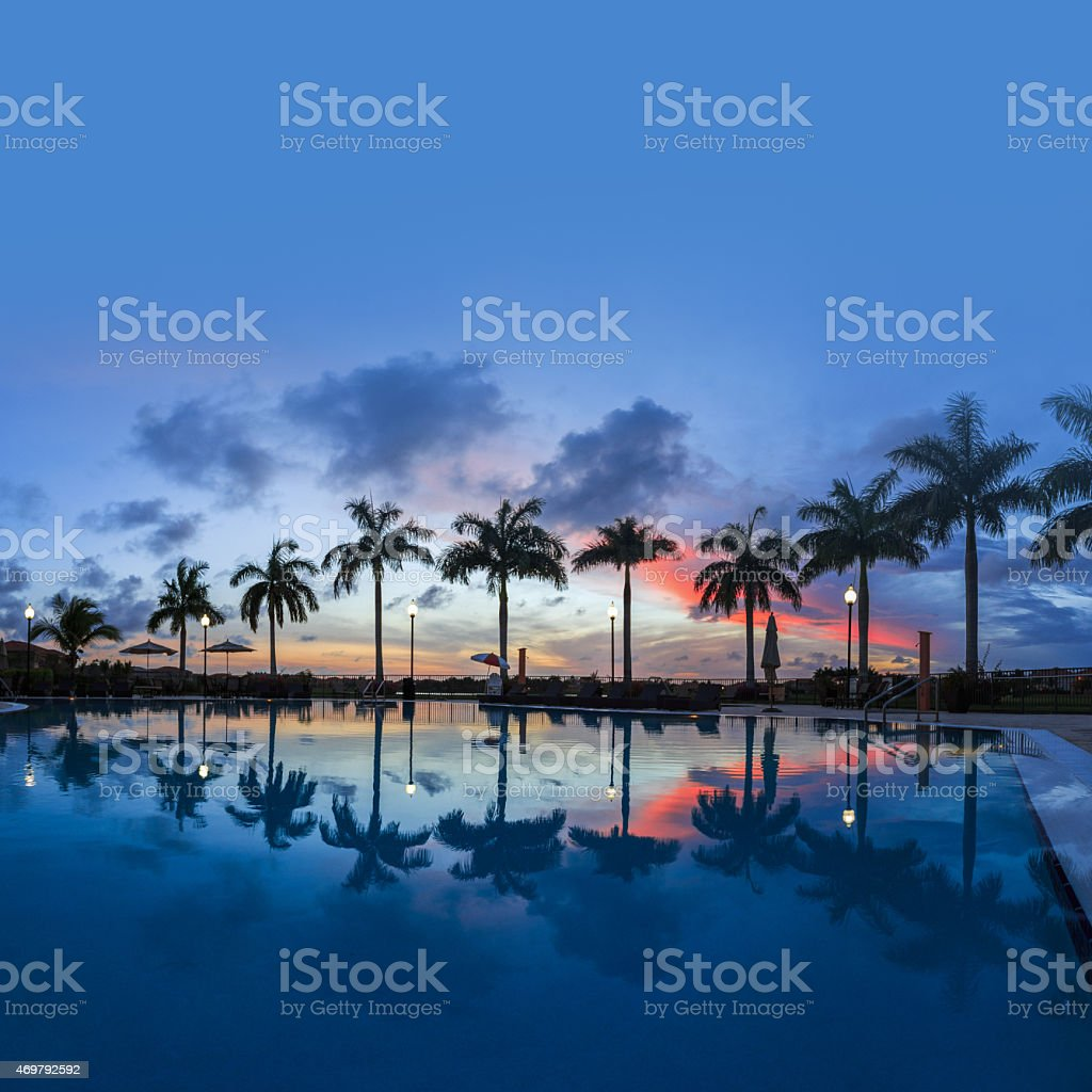 Sunset over pool stock photo