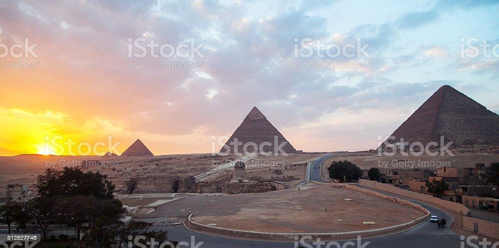 Sunset over pyramids stock photo