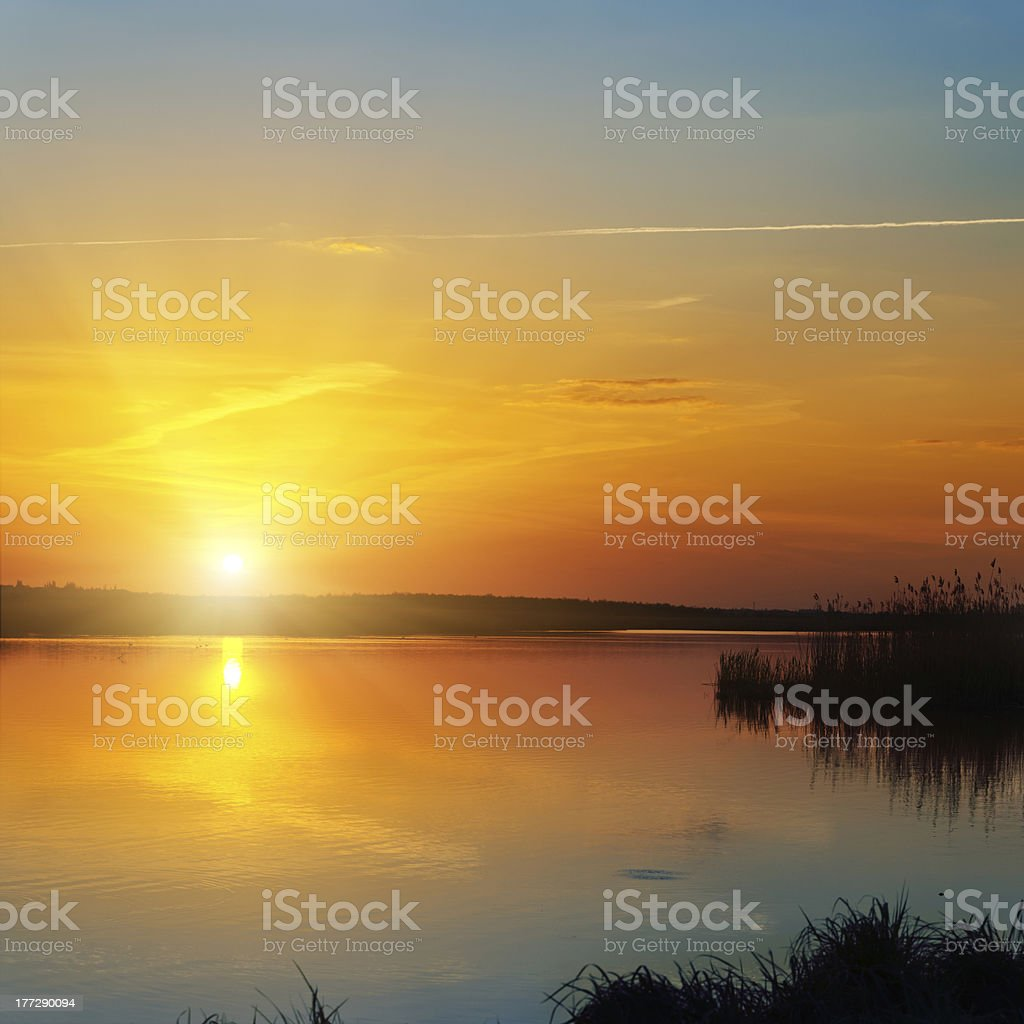 sunset over river stock photo