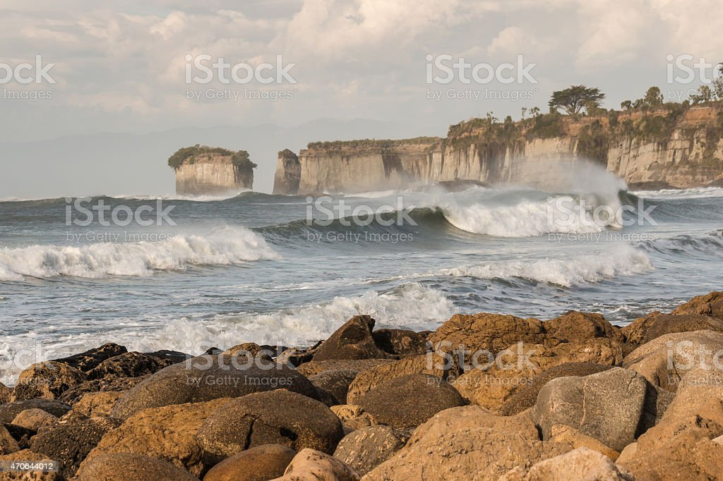 sunset over rocky beach at Cape Foulwind stock photo