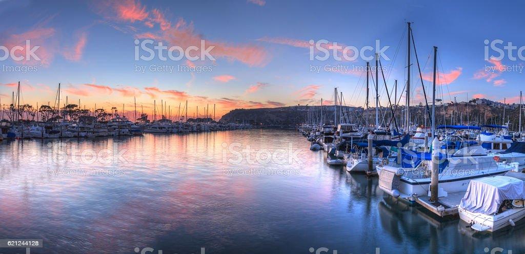 Sunset over sailboats in Dana Point harbor stock photo