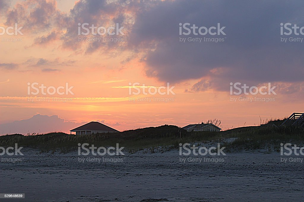 Sunset over Sand Dunes and Beach Homes stock photo