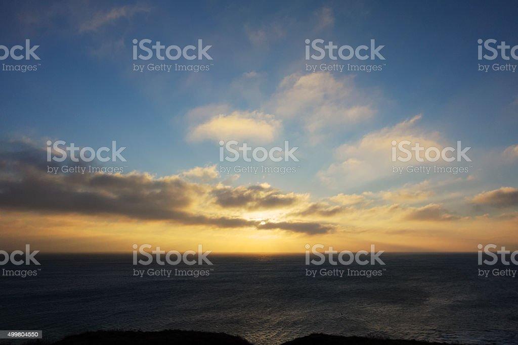 Sunset over sea at Loe Bar near Porthleven Cornwall stock photo
