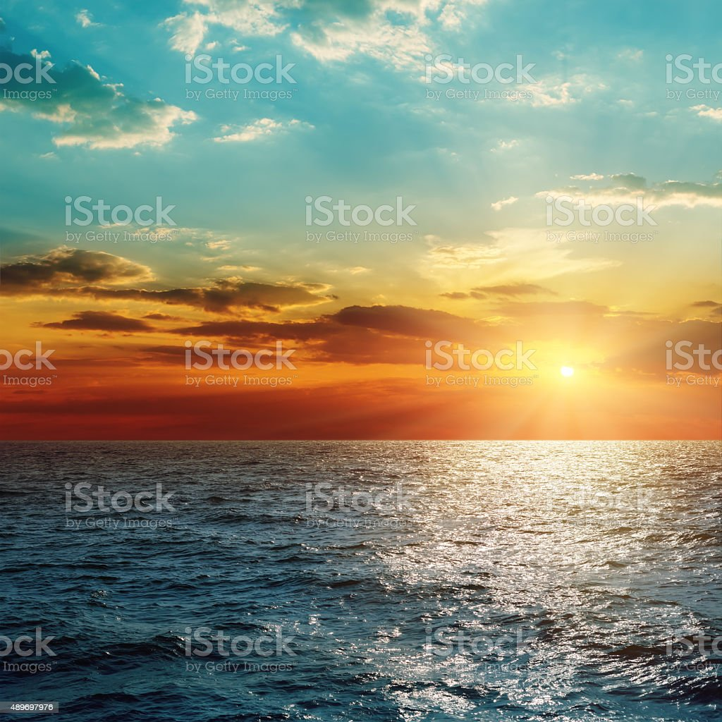 sunset over sea stock photo