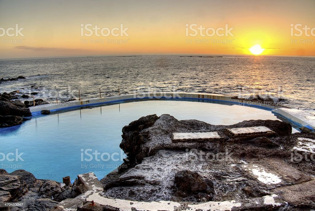 Sunset Over Sea Pool stock photo