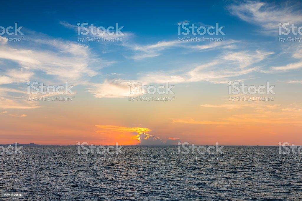 Sunset over seacoast skyline stock photo