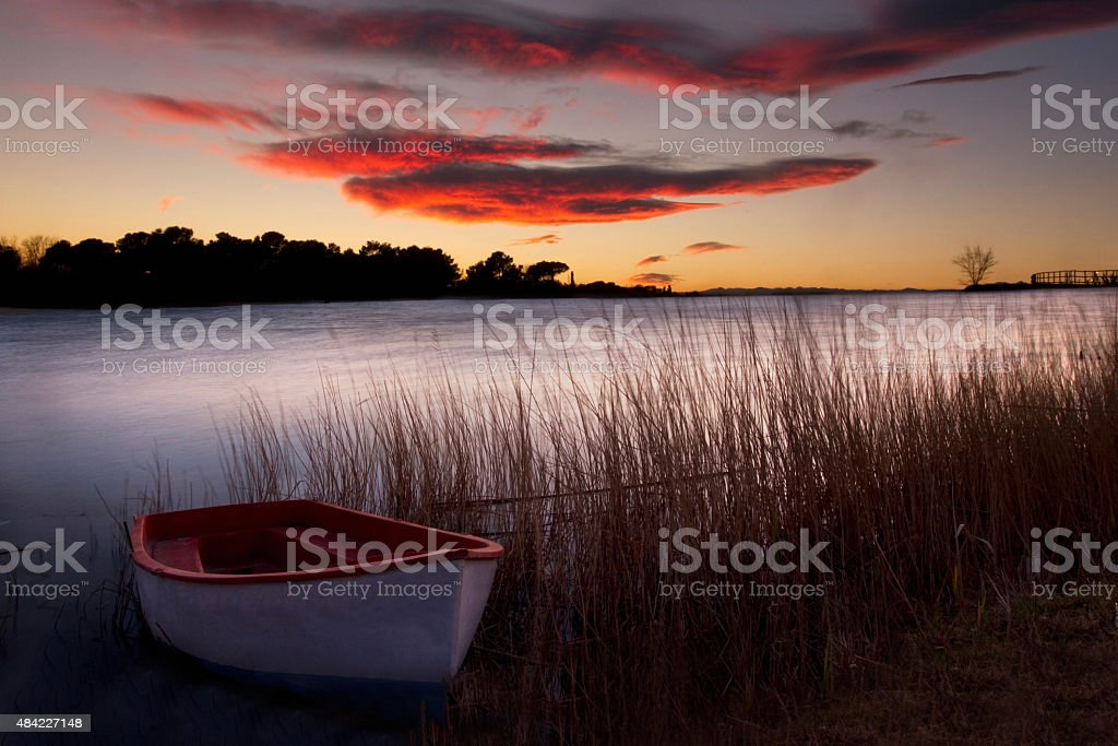 Sunset over silver river stock photo